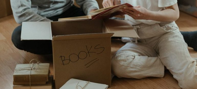 couple-packing-books