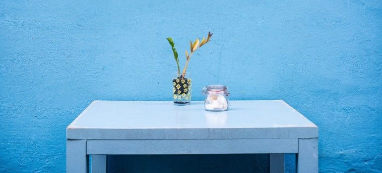 A table in front of a blue wall.