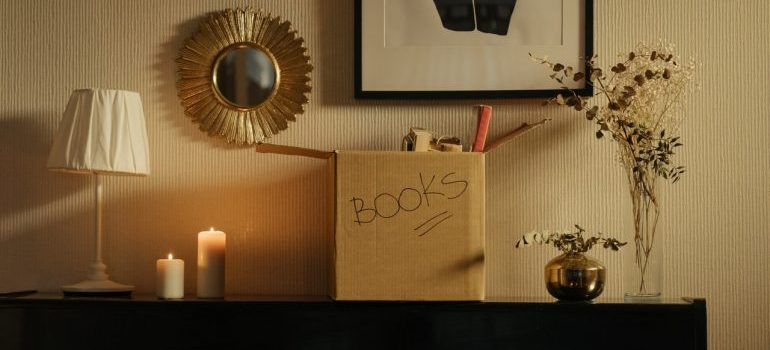 A box with books on a dresser