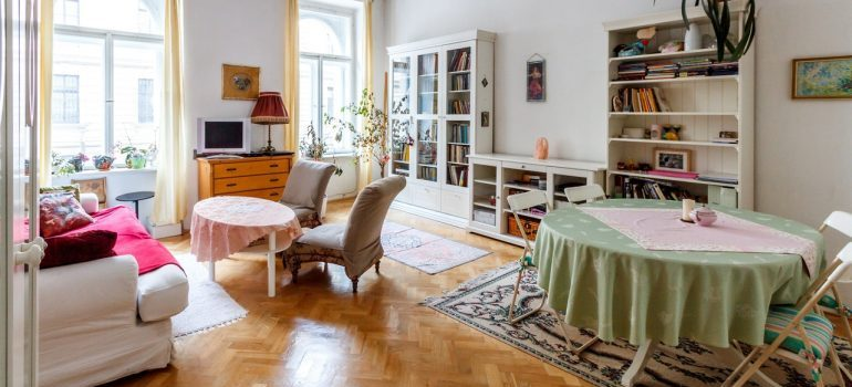 A living room and dining room before you declutter your home before moving