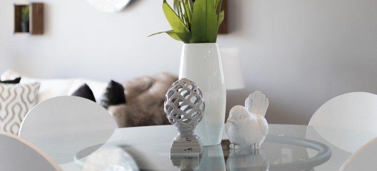 A white vase on a white table.
