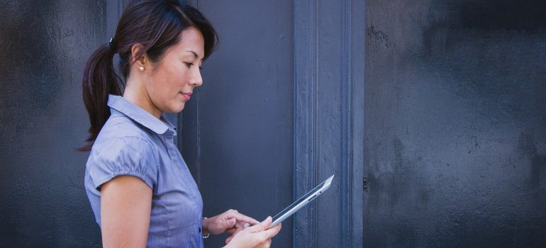 A woman holding a tablet.
