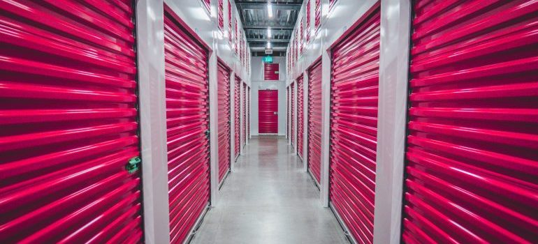 A row of storage units with red doors
