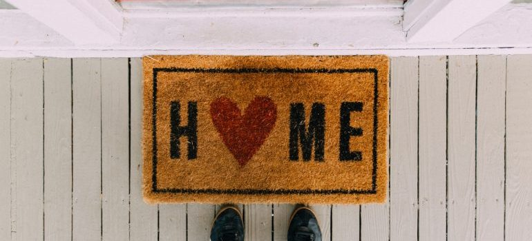 rug that says home representing Moving to New Orleans on a deadline