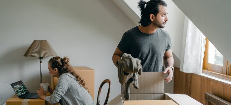 a couple unpacking after arriving to a new home