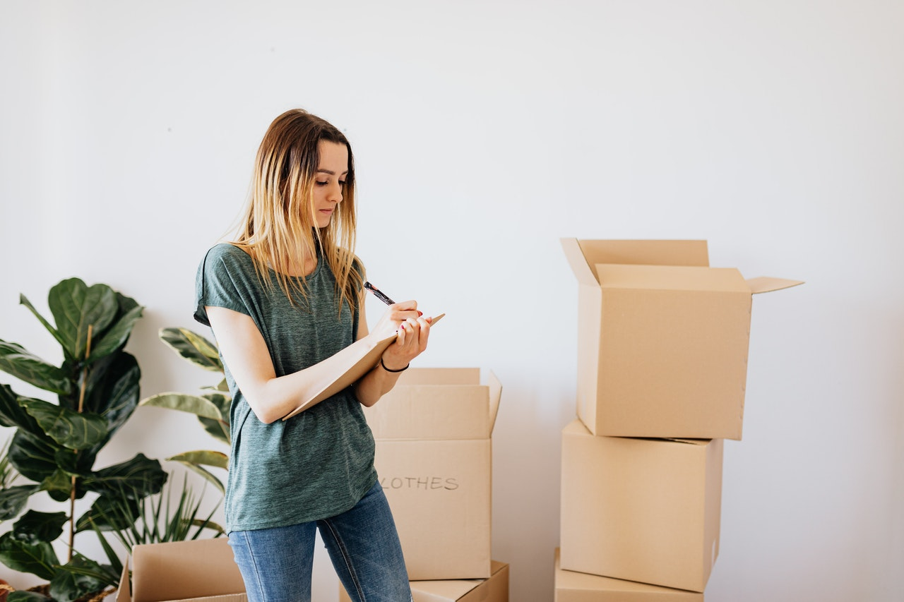 a girl packing for the move