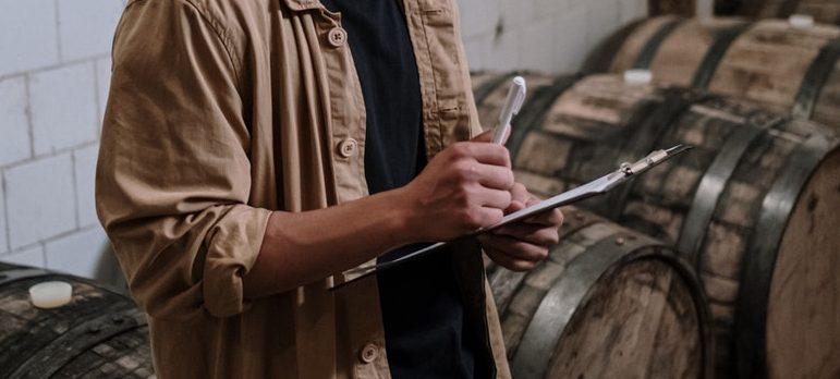 A man writing stuff down on a checklist