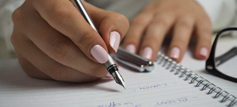 A woman writing on piece of paper