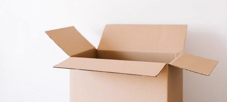 An open box on a wooden table.