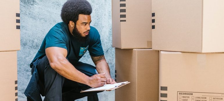 A guy checking out moving boxes