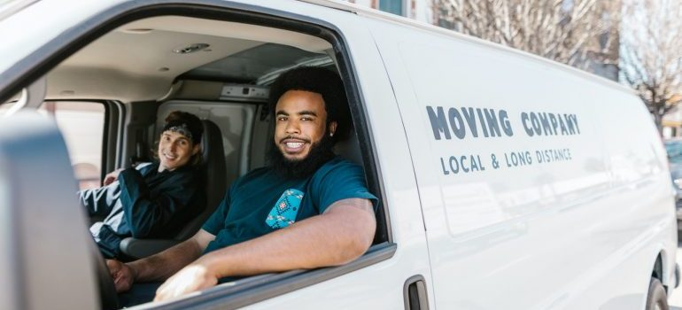 Moving and storage providers in a white van.