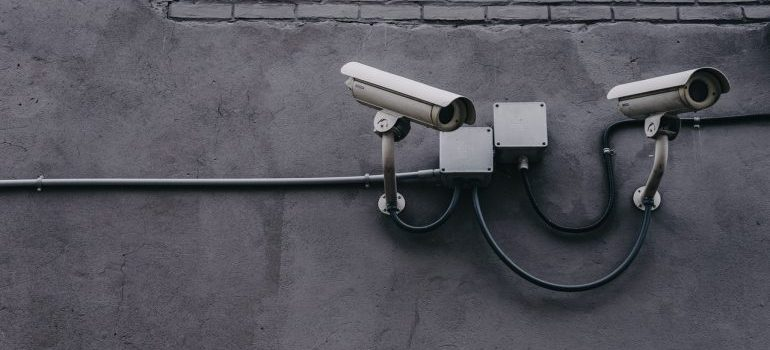 A camera, representing security in storage areas.