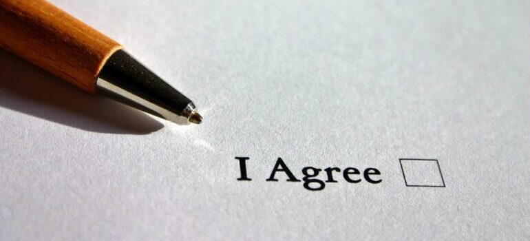 """An """"I agree"""" checkbox next to a pen"""