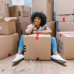 A woman sitting around boxes