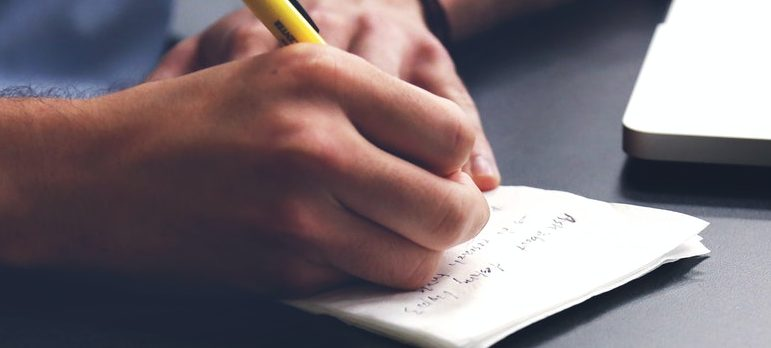 A person creating a moving checklist