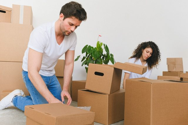 Couple packing items.