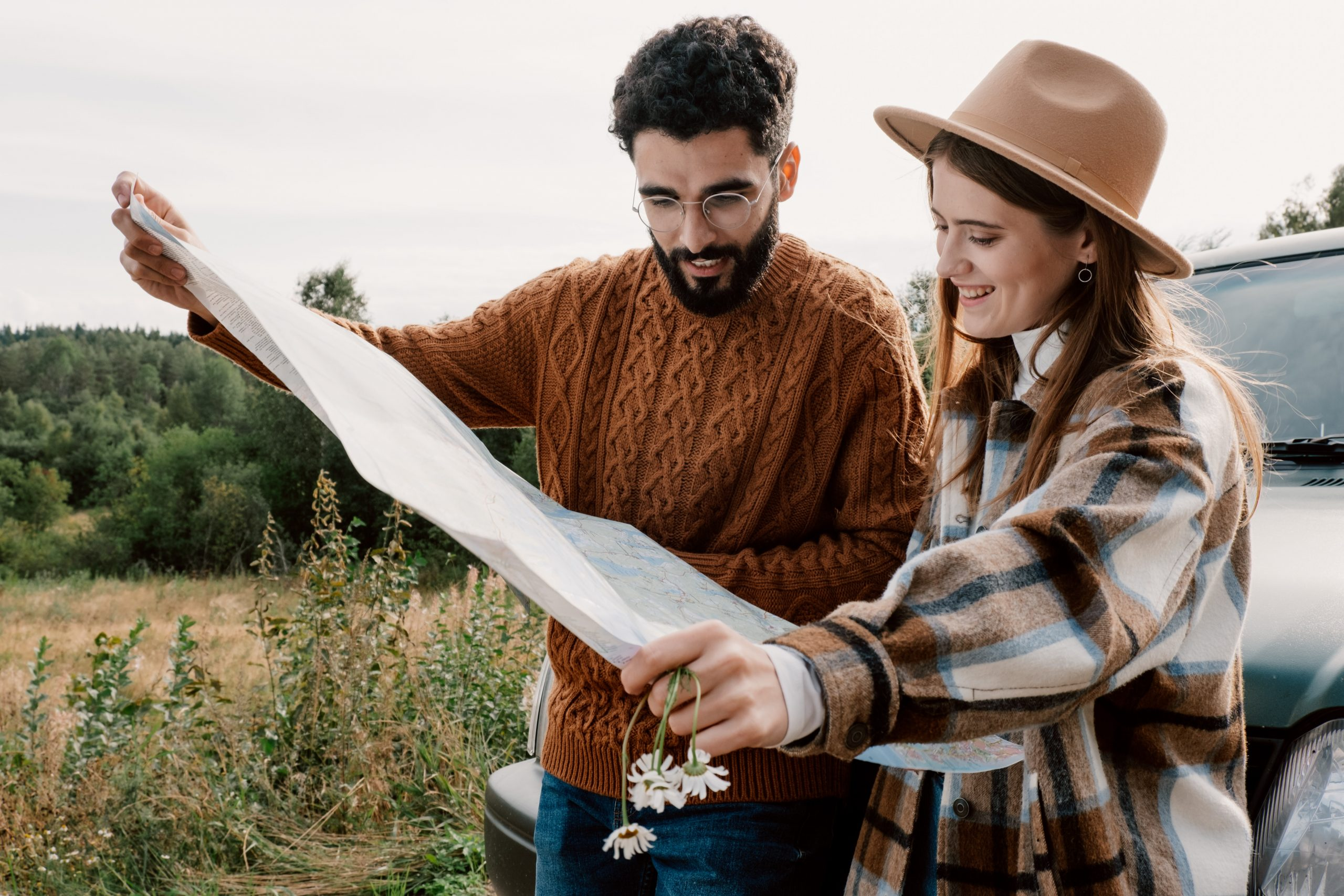 Man and woman holding a map