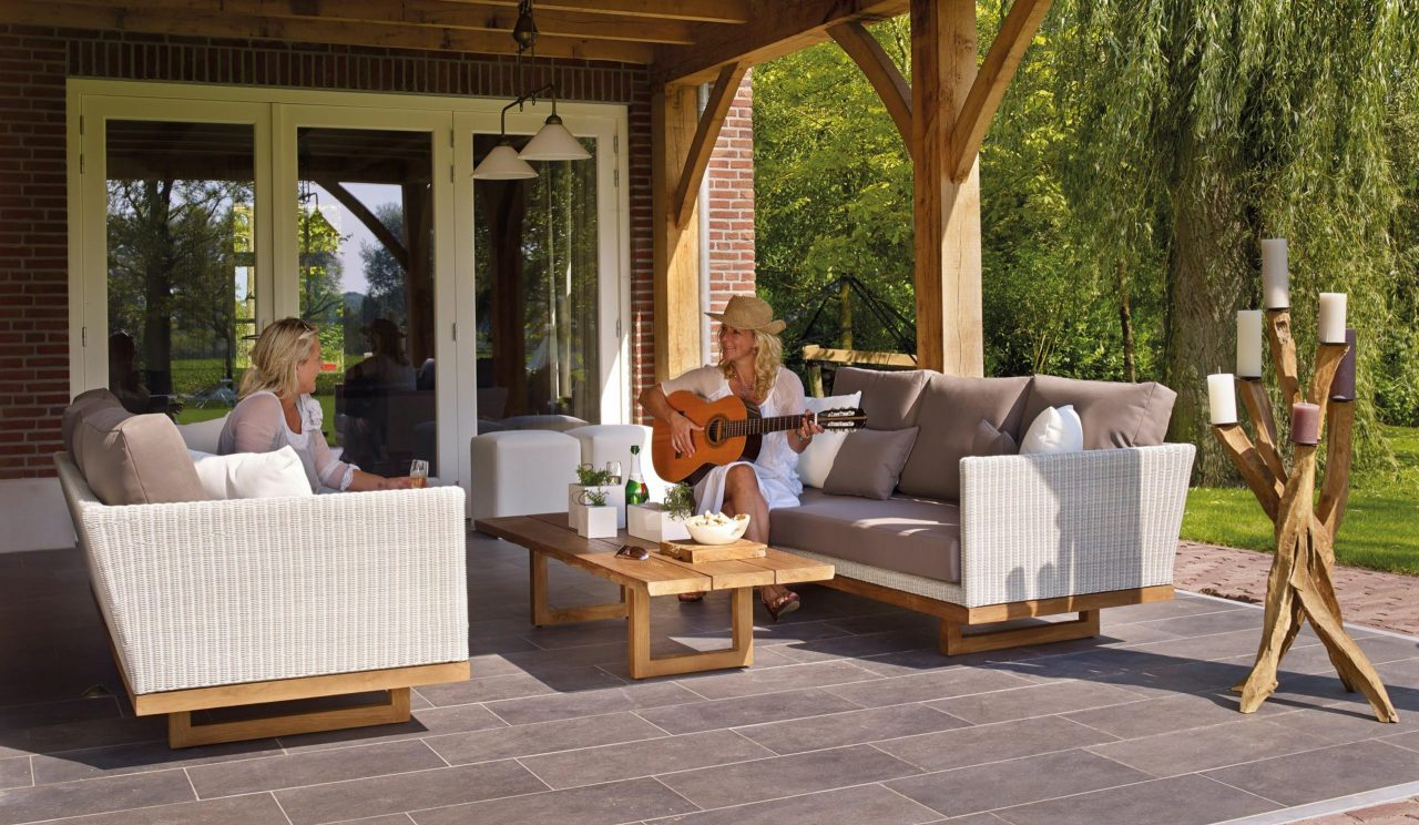two girls sitting on a patio, one playing guitar, on storing your patio set in Metairie